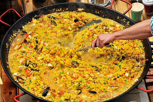 seafood spanish paella - paella stock photos and pictures