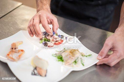 istock Seafood Starter Preparation in the Restaurant Kitchen 629808336