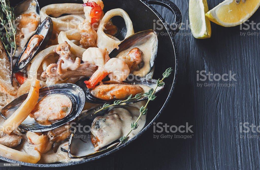 Seafood Stew in Saucepan closeup on dark wood background – Foto