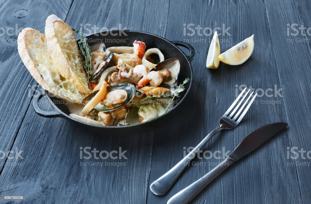 Seafood Stew in Saucepan on dark wood background – Foto
