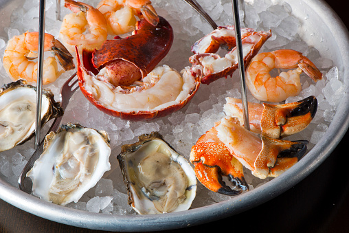 Oysters, shrimp, lobster, crab legs, caviar. Fresh oysters served with shallots and cocktail sauce, mignonette sauce and fresh lemons and limes. Classic American steakhouse or French bistro appetizer.