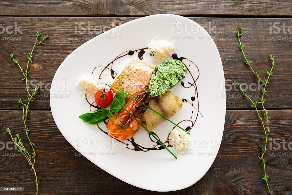 Seafood variety on white plate flat lay stock photo