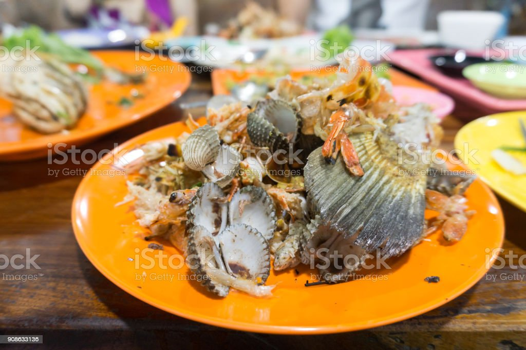 Seafood waste after eating at Thailand restaurant stock photo