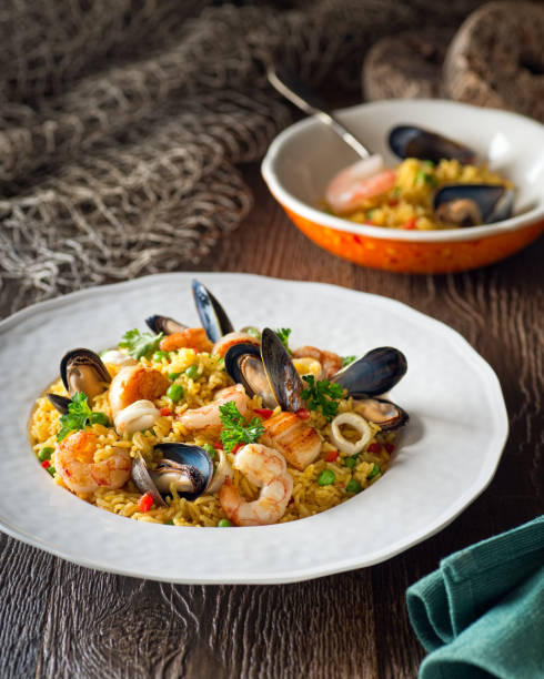 seafood with rice - paella stock photos and pictures