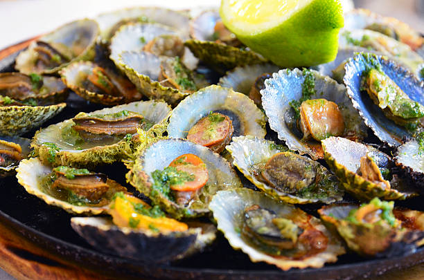 seafood.grilled limpets.madeira's traditional dish. - lapa imagens e fotografias de stock