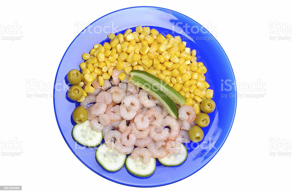 Seafoods and vegetables on the blue plate royalty-free stock photo