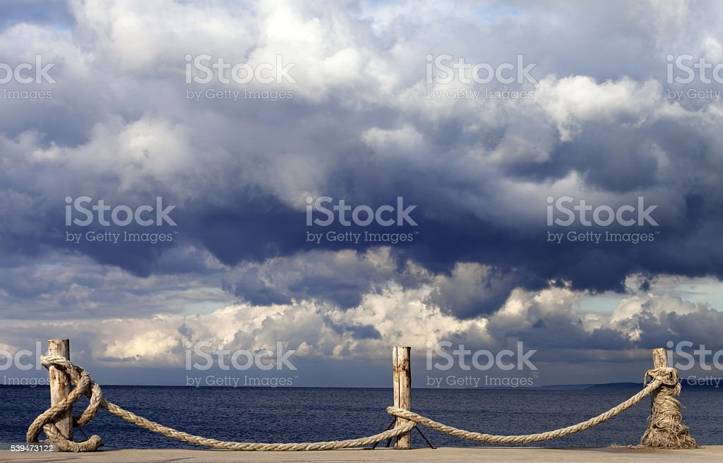 Seafront and cloudy storm sky in autumn stock photo