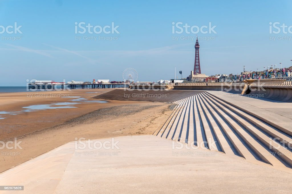 Seafront leading to the Blackpool Tower by the beach in Blackpool, Lancashire stock photo