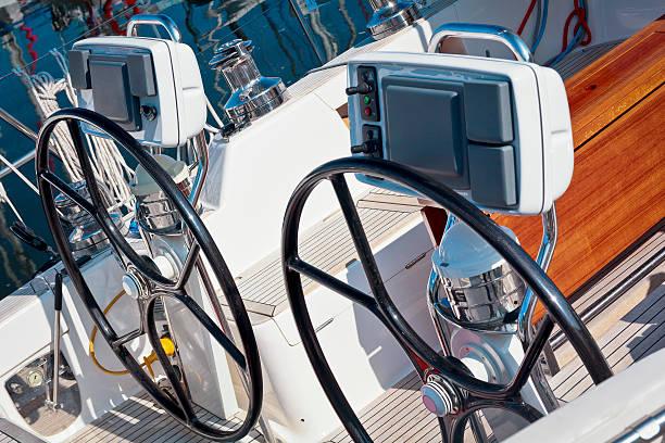 seagoing yacht steering wheels - steuerungstechnik stock-fotos und bilder