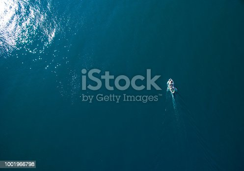 811600544 istock photo Seagulls following The Fishing Boat 1001966798