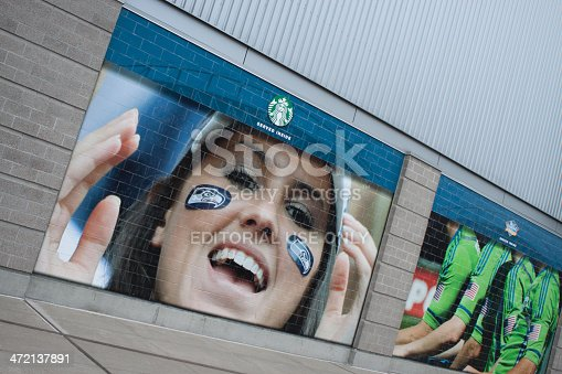 Seattle, United States - January 23, 2014: This image shows the exterior of Centurylink Stadium in Seattle, Washington where a Starbucks advertisement with a Seattle Seahawks fan photo on it is posted, showing support for the Hawks! The Seahawks football team is playing in the Superbowl and fans in Seattle and the Northwest are very excited.