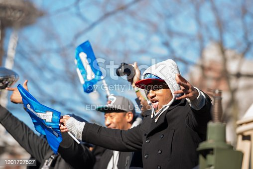 Seattle, USA - February 5th, 2014: Malcolm Smith waving at the crowd during the Seahawks homecoming parade on 4th avenue after the XLVIII Super Bowl win.