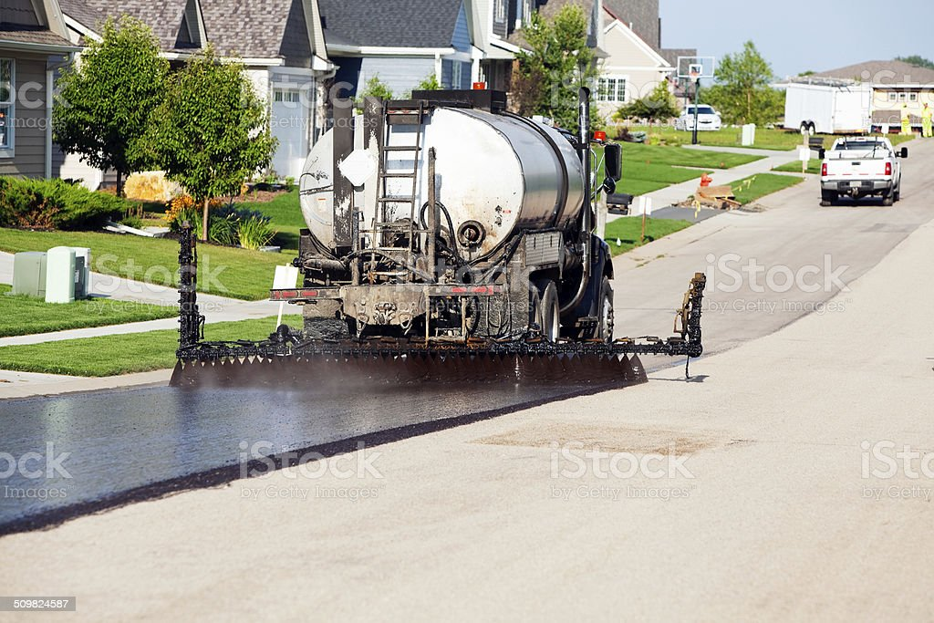 Seal Coating for Chip Sealing Asphalt Pavement Street stock photo
