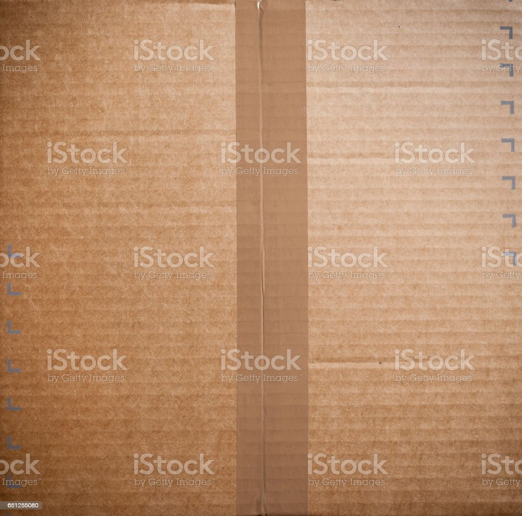 Sealed carboard box with brown packing tape stock photo