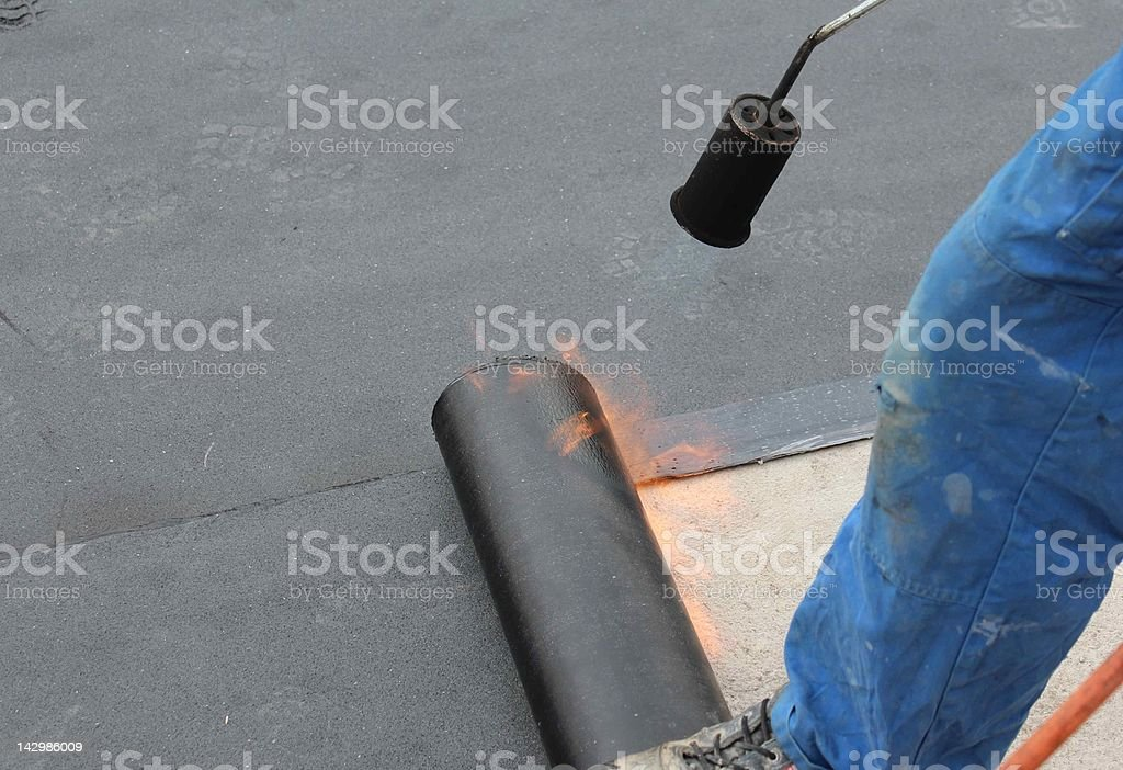 Sealing a flat roof stock photo