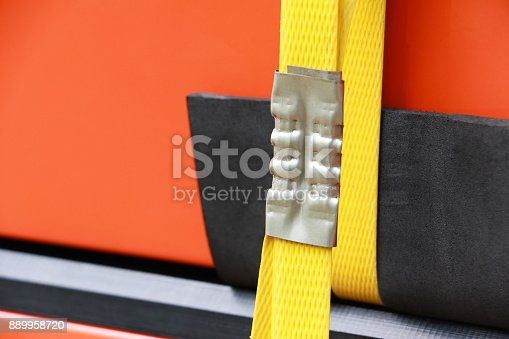 istock Sealing steel strapping with the seal less combination tool or poly strapping tools. 889958720