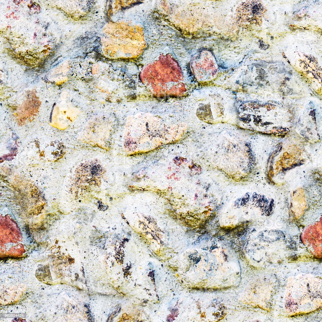 Seamless background of old stone wall texture photo. Colorful old stone wall. - Royalty-free Antique Stock Photo
