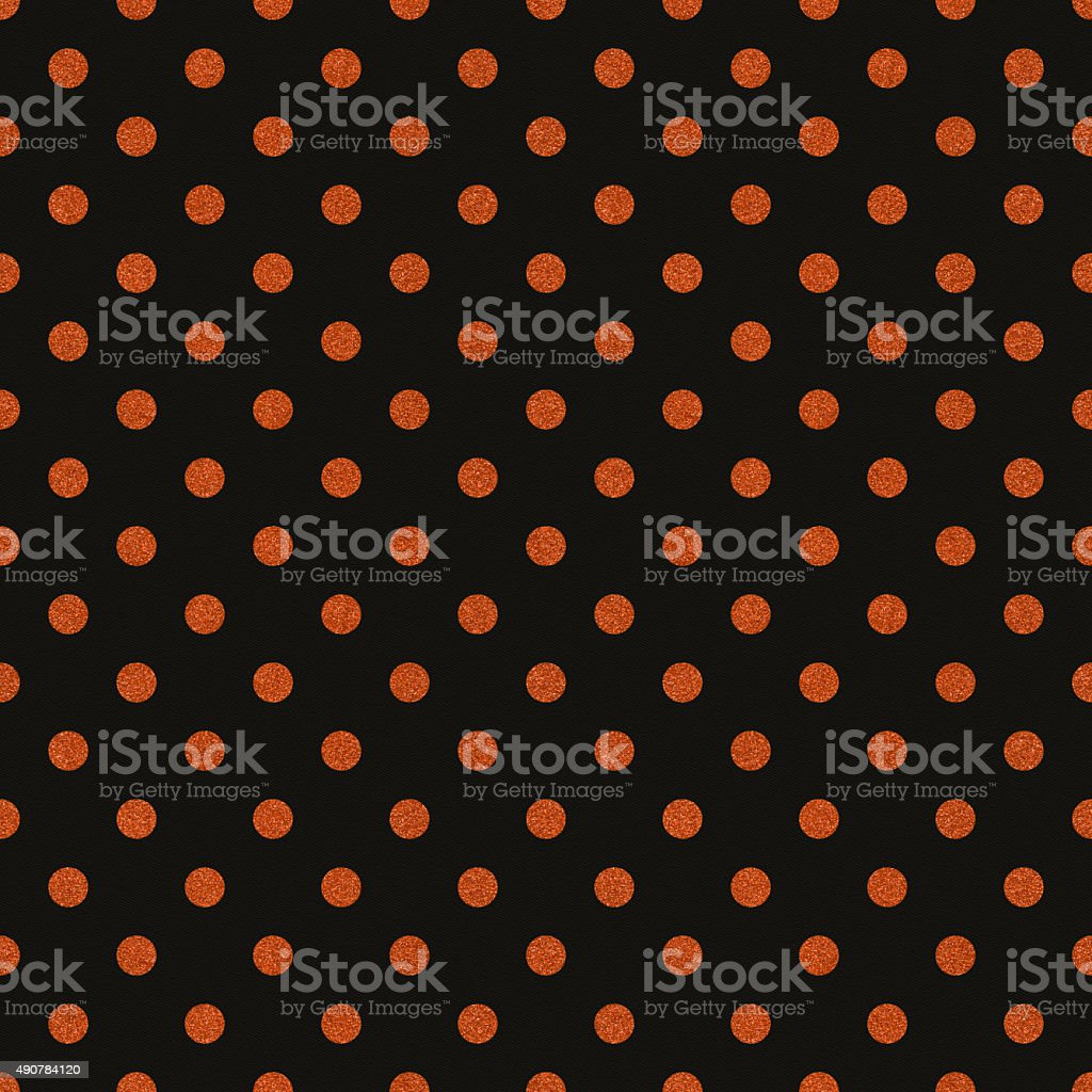 Seamless black paper with orange glitter dots stock photo