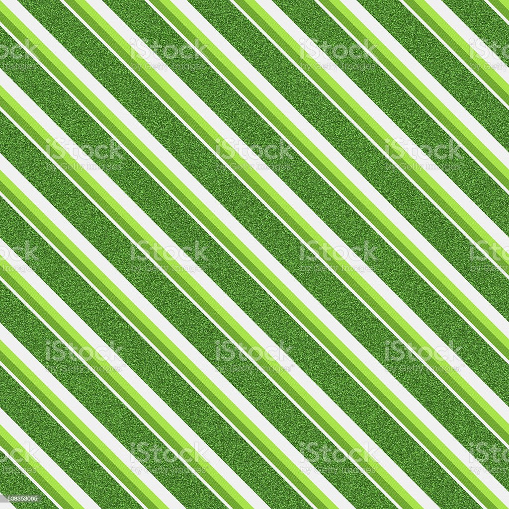 Seamless green ink and glitter stripes on white paper royalty-free stock photo