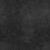 Seamless grunge uneven black stone texture background with visible components.