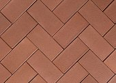 Seamless herringbone paving slabs texture in brick red