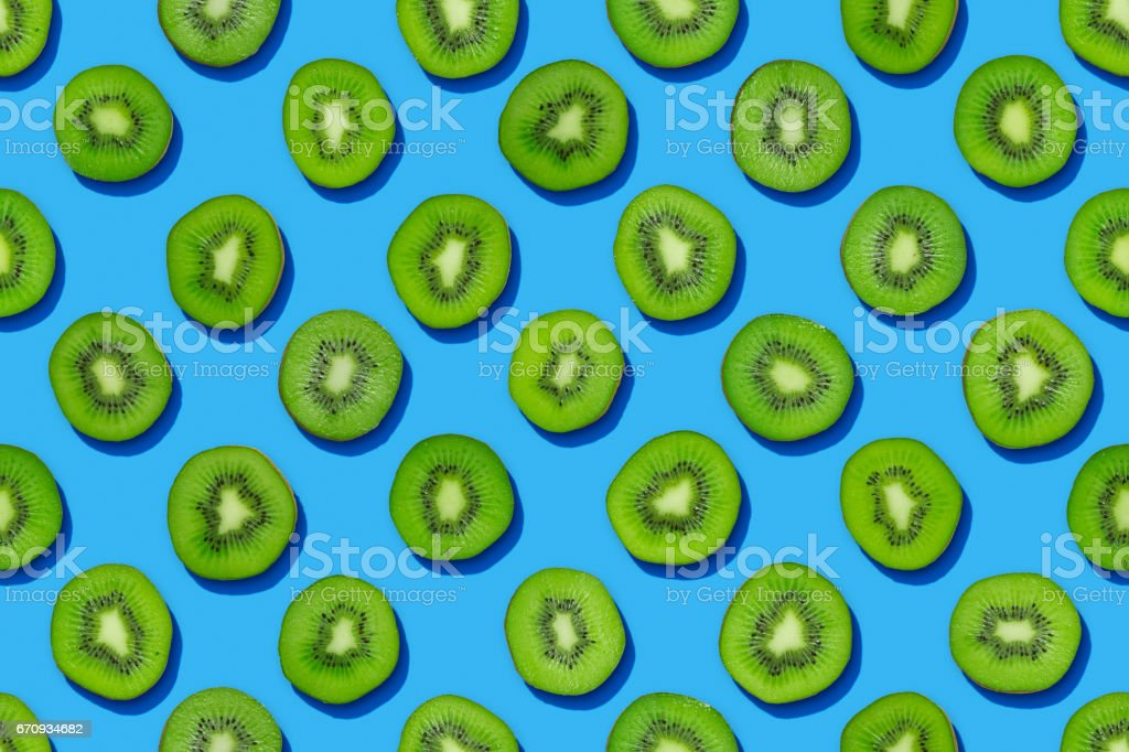 Seamless kiwi pattern on blue background stock photo