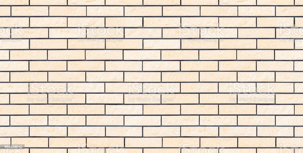 Seamless light beige new and clean brick wall stock photo