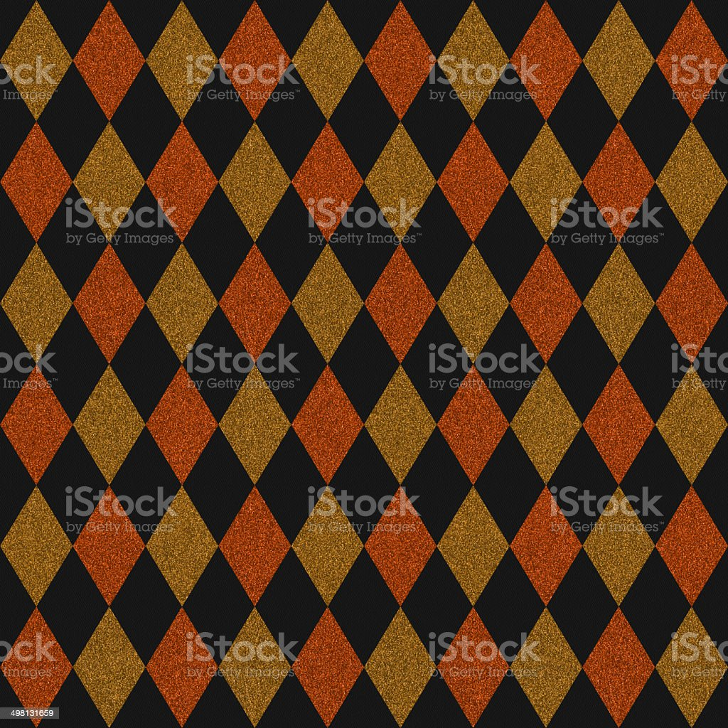 Seamless orange and gold glitter diamonds on black paper stock photo