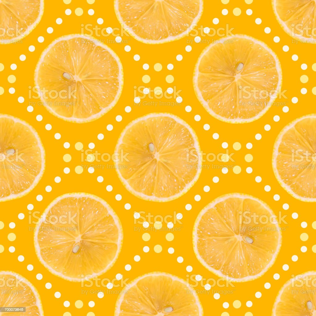 Seamless pattern made of Lemon slice isolated and dots on a yellow background. stock photo