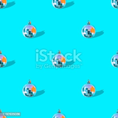 istock /Seamless pattern made with various decoration balls for Christmas tree and New Year on bright baby blue color background with strong shadows 1192635036
