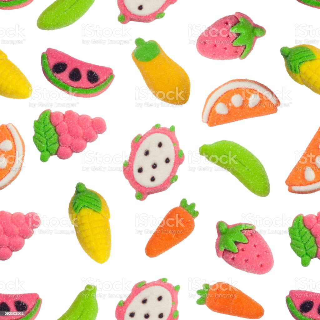 Seamless pattern of fruit and vegetable shaped gummy candy stock photo