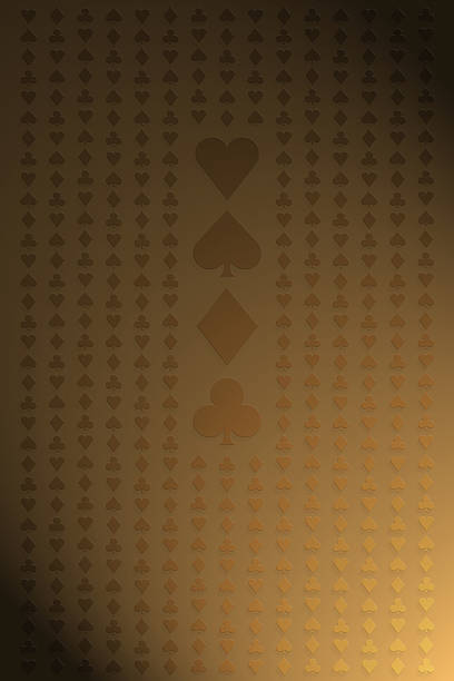 Seamless pattern of playing card suit symbols on gold  stock photo