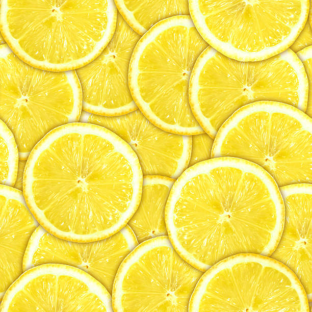 Seamless pattern of yellow lemon slices Abstract background of heap fresh yellow lemon slices. Seamless pattern for your design. Close-up. Studio photography. limoen stock pictures, royalty-free photos & images