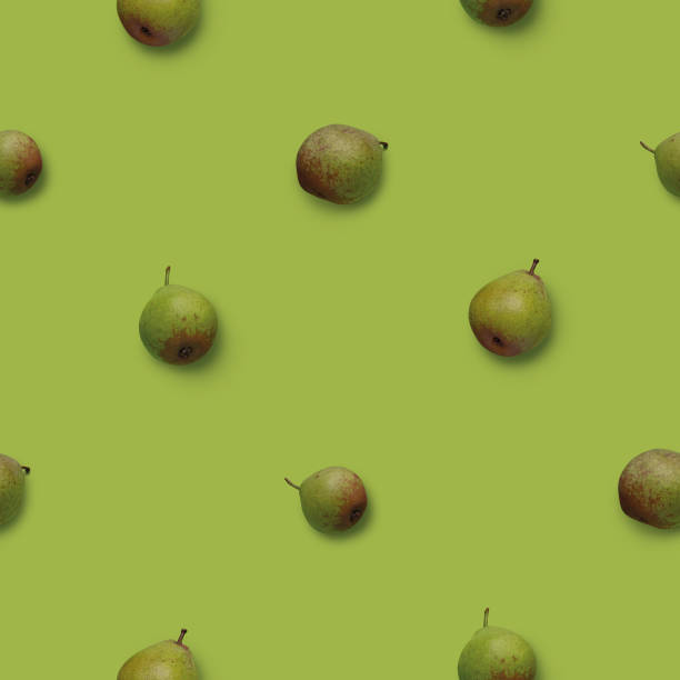 Seamless pattern with green pears photos on green background stock photo