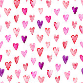 Seamless pattern with pink watercolor hearts. Hand drawn ink illustration. Ornament for wrapping paper. Ornament for Valentine's day.