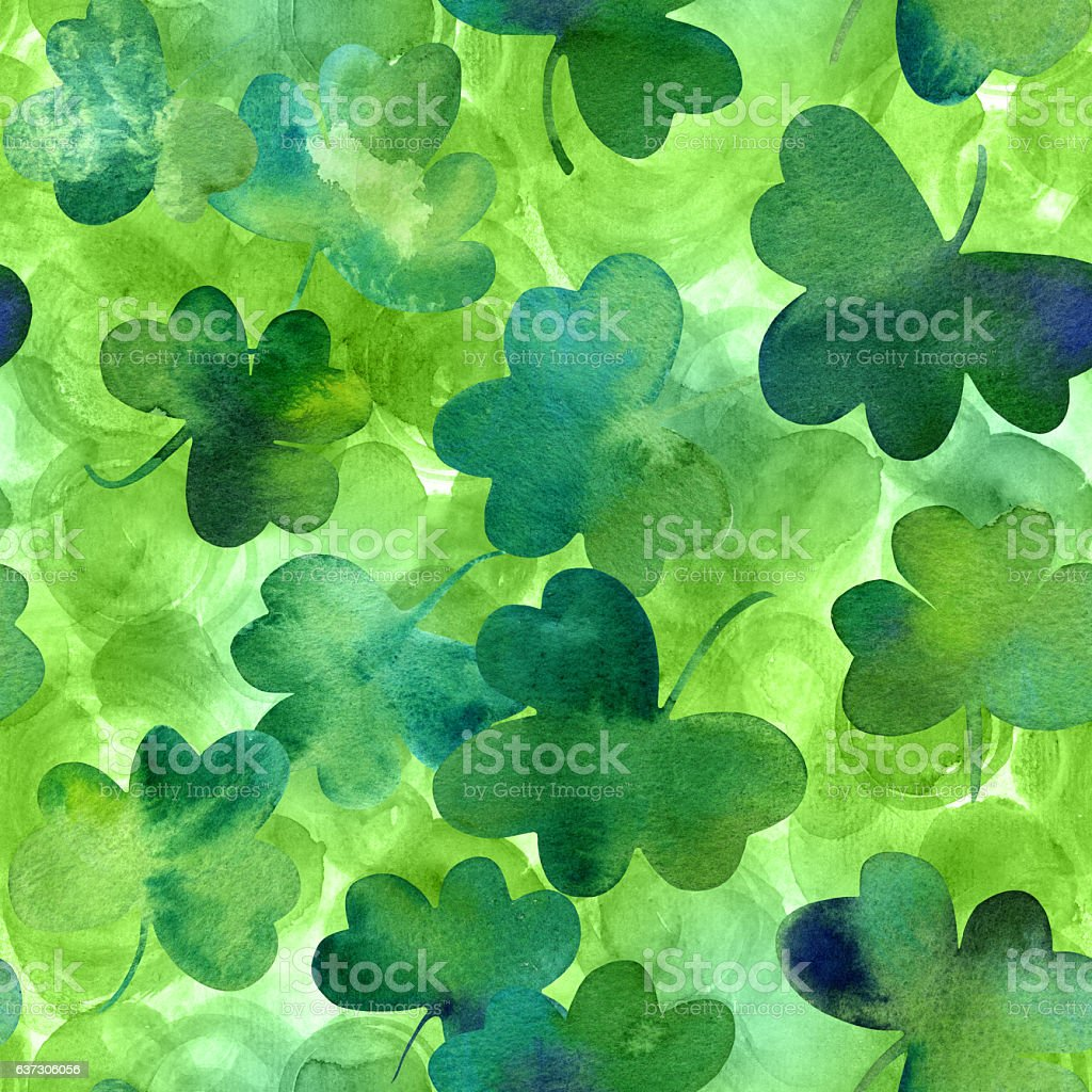 Seamless pattern with watercolour shamrocks on green stock photo