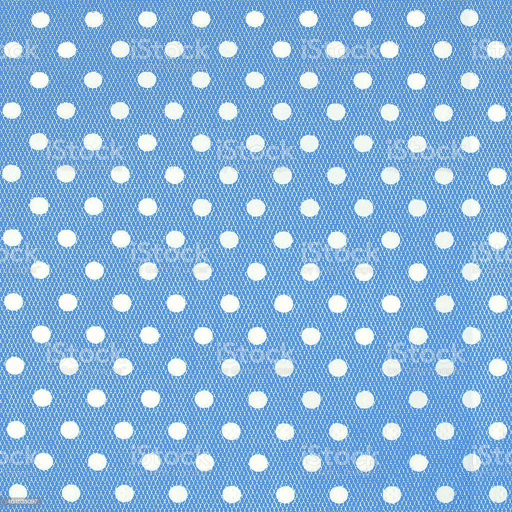 Seamless pattern with white polka dots on a blue background. royalty-free stock photo