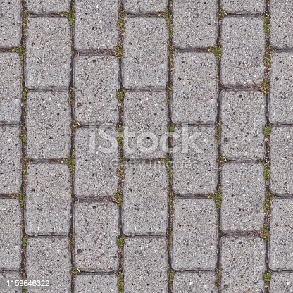 Abstract seamless texture for designers with stone pavement. There are green grass between blocks. Surface of rocks contain corrosion and cracks.