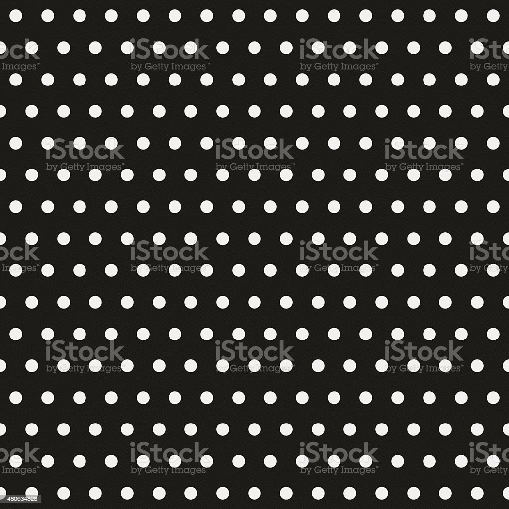 Seamless polka dot pattern on black paper stock photo