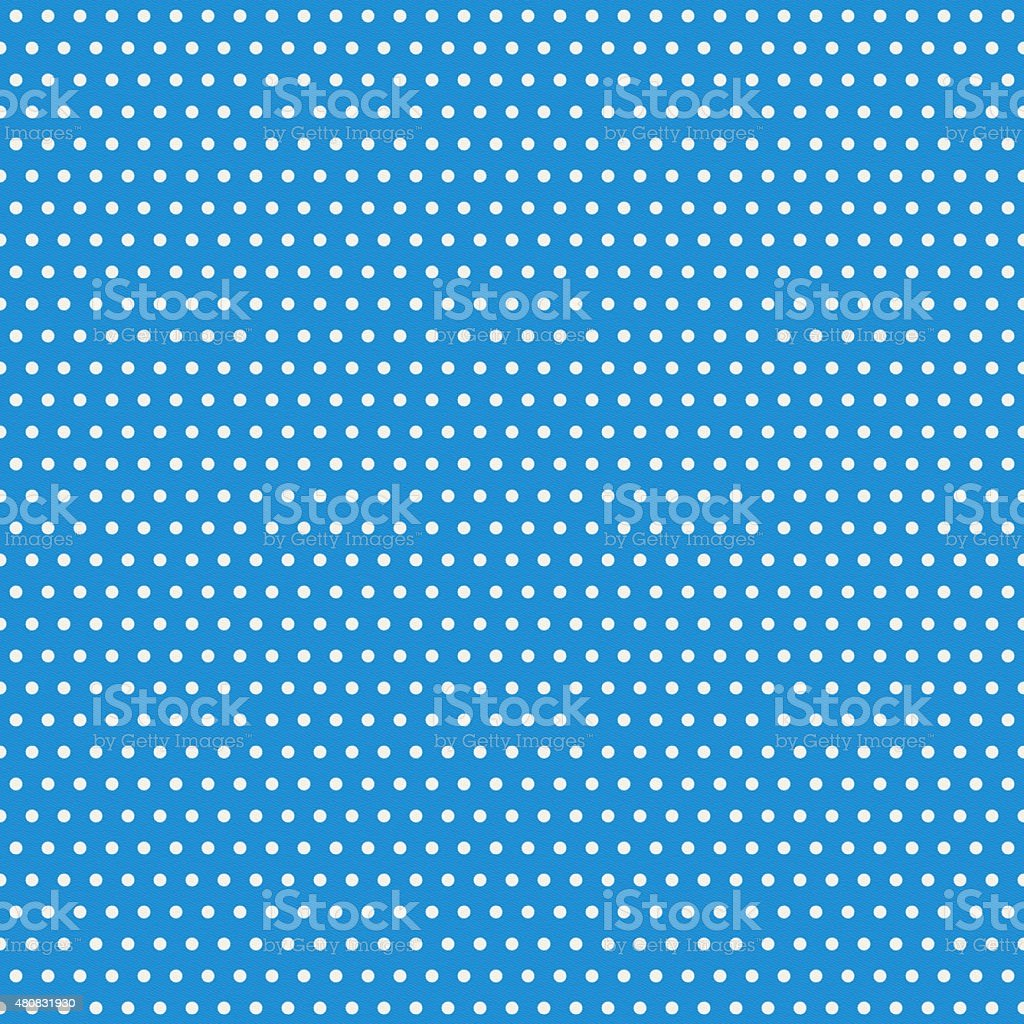 Seamless polka dot pattern on blue paper stock photo