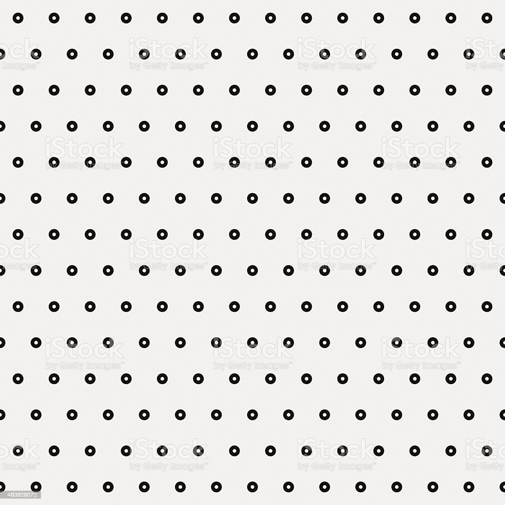 Seamless polka dot pattern on white paper stock photo