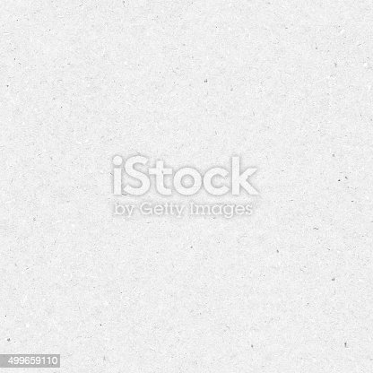 istock Seamless raw flat recycled handmade light gray eco cardboard background 499659110