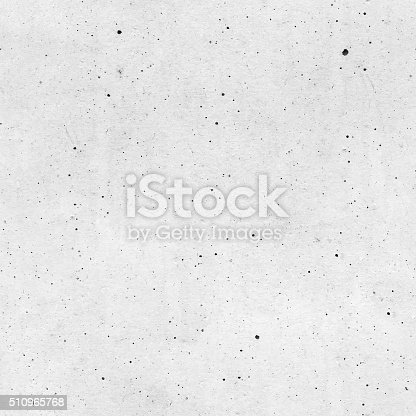 istock Seamless raw unfinished dirty dotted white painted concrete wall background 510965768