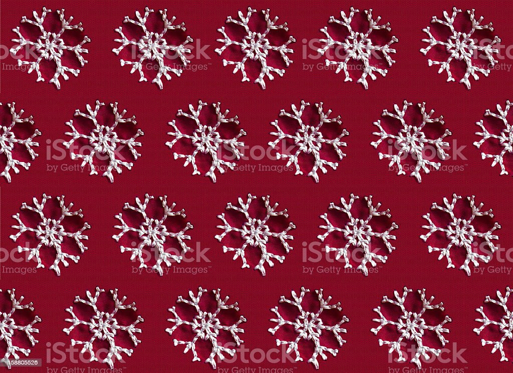 Seamless red fabric background with snowflakes royalty-free stock photo
