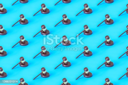 Seamless repetitive Gavel and Sounding Block pattern on blue background