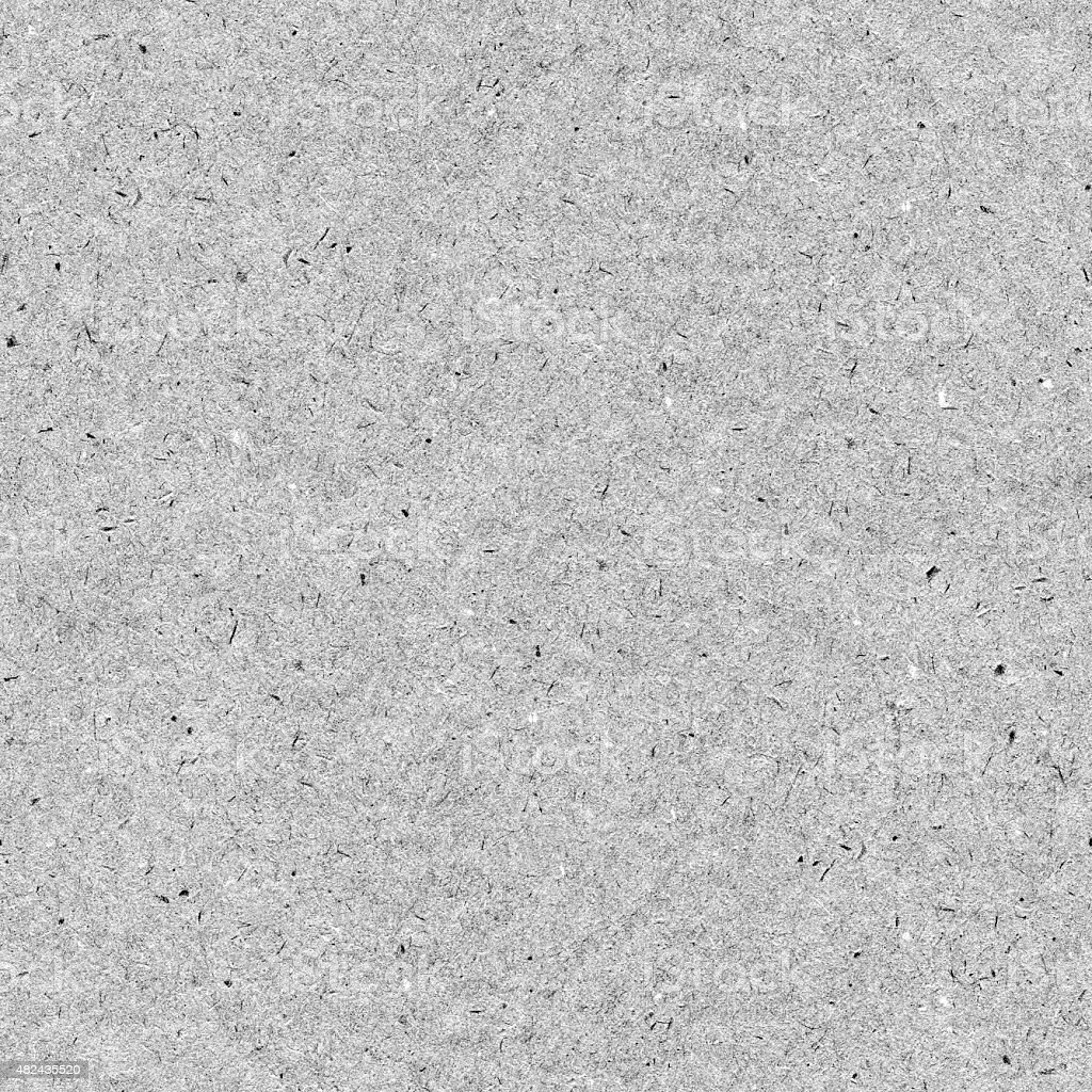 Seamless rough messy dotted polluted detailed gray handmade paper background stock photo