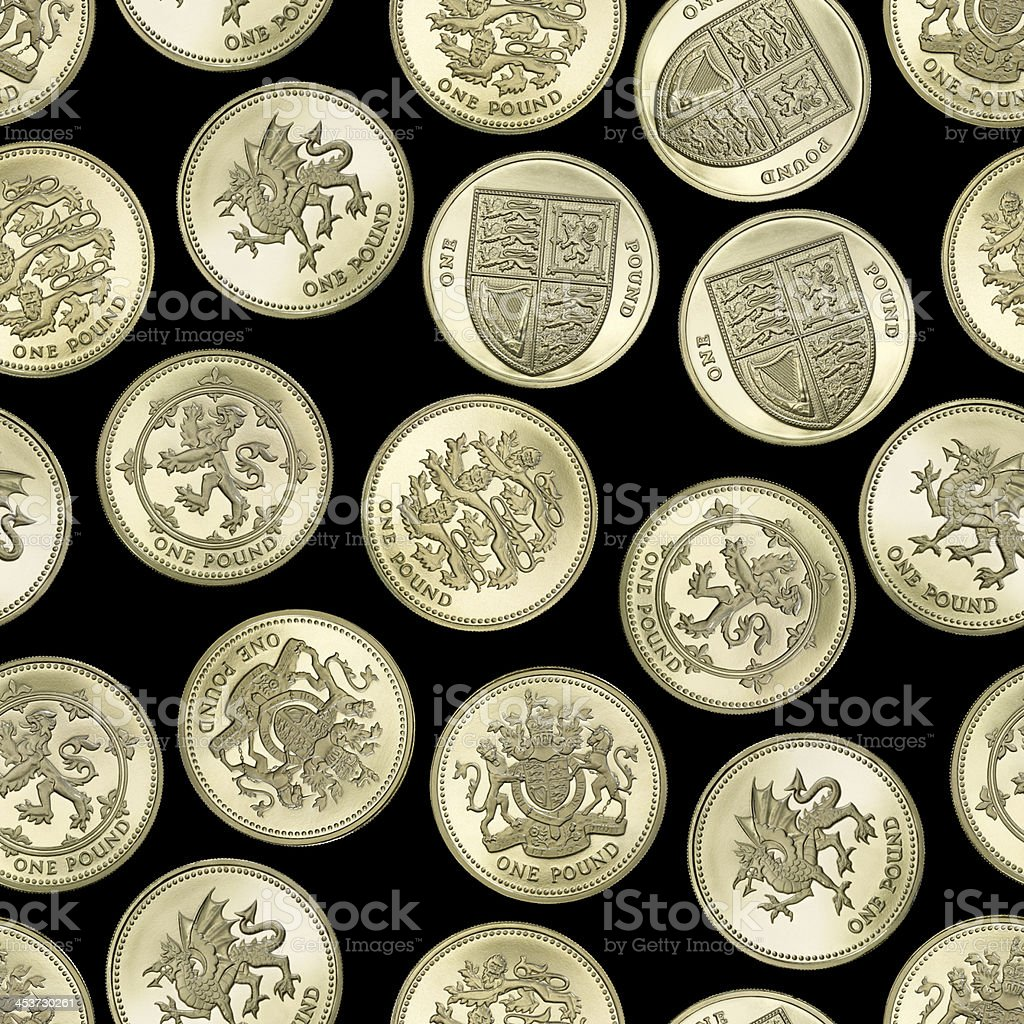 Seamless texture of British One Pound coins on black background stock photo