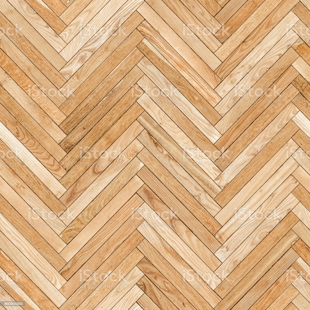 Seamless texture of old parquet from natural wood (herringbone) royalty-free stock photo