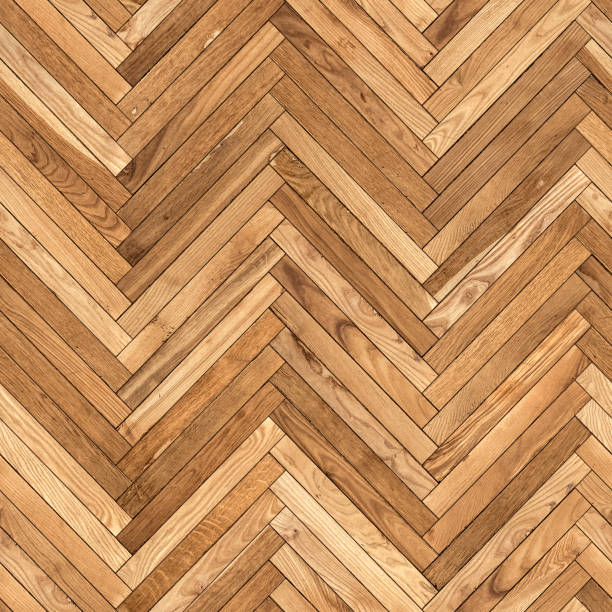 Seamless texture of old parquet from natural wood (herringbone) stock photo