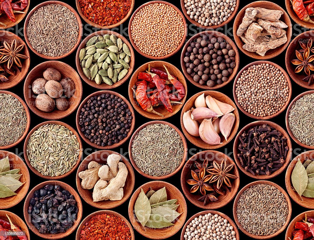 Seamless texture of spices on black royalty-free stock photo